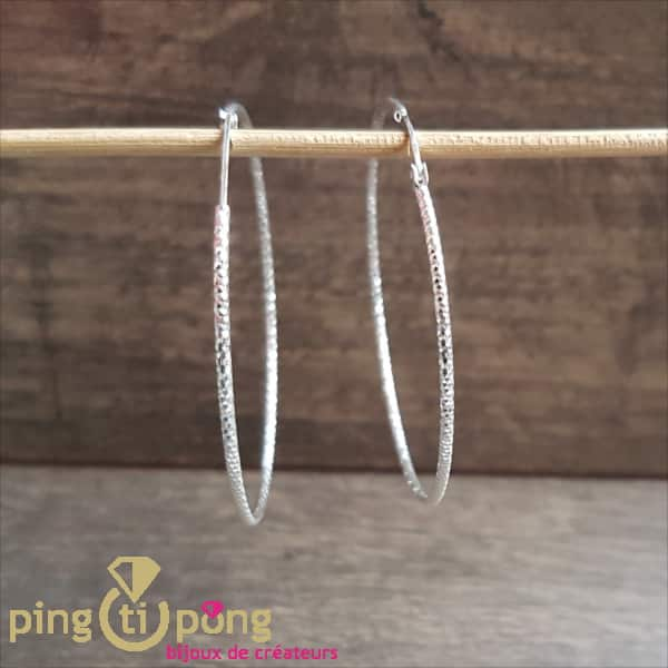 Rhodium-plated silver jewellery: hammered silver creoles from CANYON