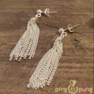Bijoux originaux : Boucles pompons en argent rhodié de CANYON