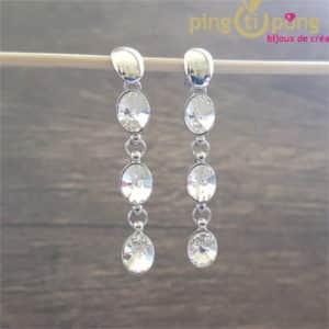 Swarovski Jewellery: White waterfall earrings in rhodium-plated silver and Swarovski diamond crystals by SPARK