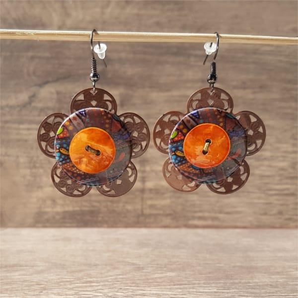 Bijoux fantaisie : Fleur bouton orange de Pingtipong