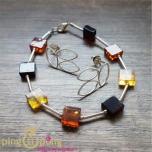 Composition de bijoux originaux : bracelet ambre et boucles argent BALTICAMBRE et KELIM Design